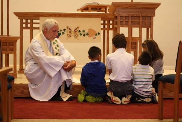 Pastor Mike leads a children's sermon